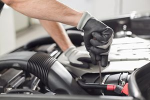 Cropped image of automobile mechanic repairing car